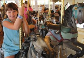 Young girl riding carousel