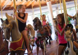 Young girls riding carousel