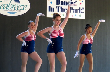 Dancers pose during amusement show at Seabreeze.