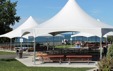 Picnic Grove white tent rentals with picnic tables.