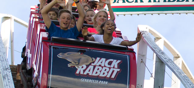 People laughing and screaming on the Jack Rabbit roller coaster ride.