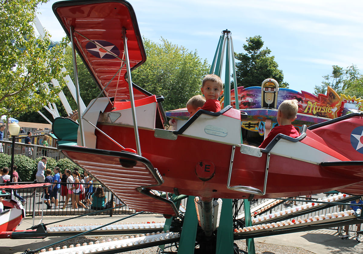 Boys riding the Barn Stormer airplane kiddie ride at Seabreeze.