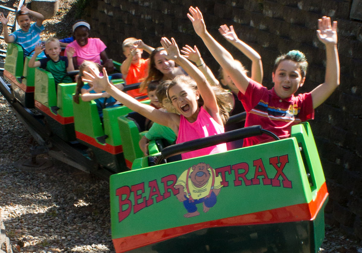 Children ride the Bear Trax kiddie rollercoaster ride.