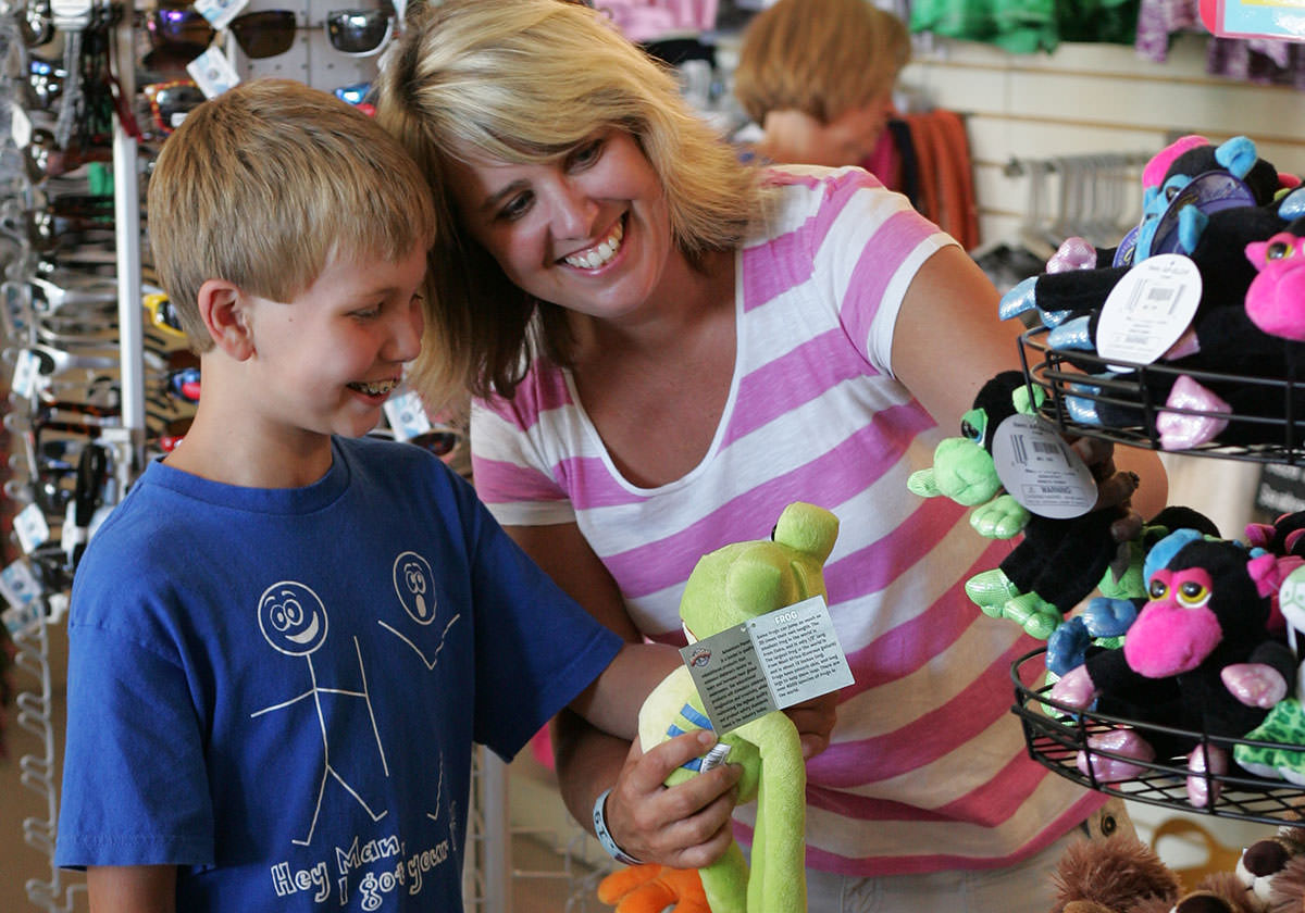 Child and mother browse stuffed animals in the Gift Shop.