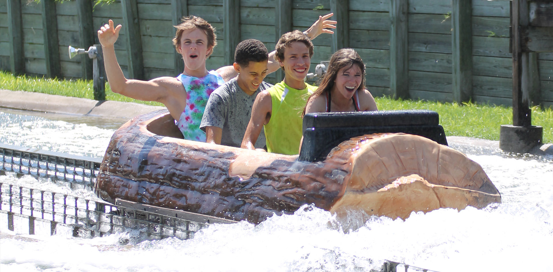 People laughing after getting wet on the Log Flume ride.