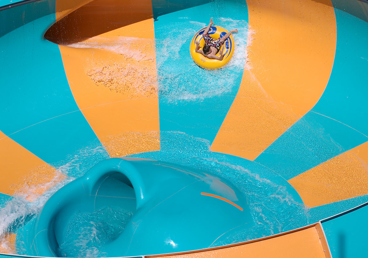 Child in an inner tube riding on the Helix water ride.