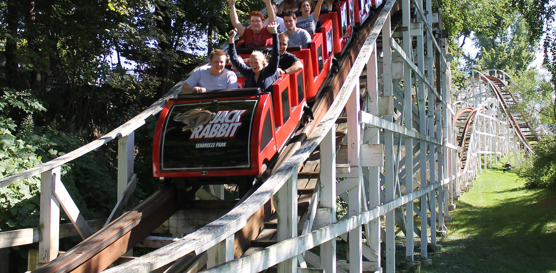 Riders come down a hill on the Jack Rabbit roller coaster ride.