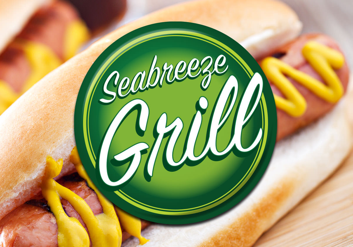 Seabreeze Grill Logo in front of a hot dog with mustard.