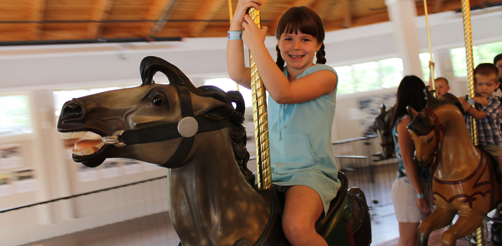 Girl on Carousel Ride