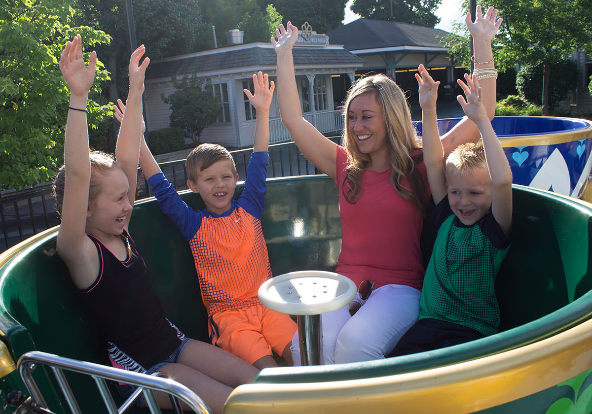 People riding the Tea Cups ride at Seabreeze.