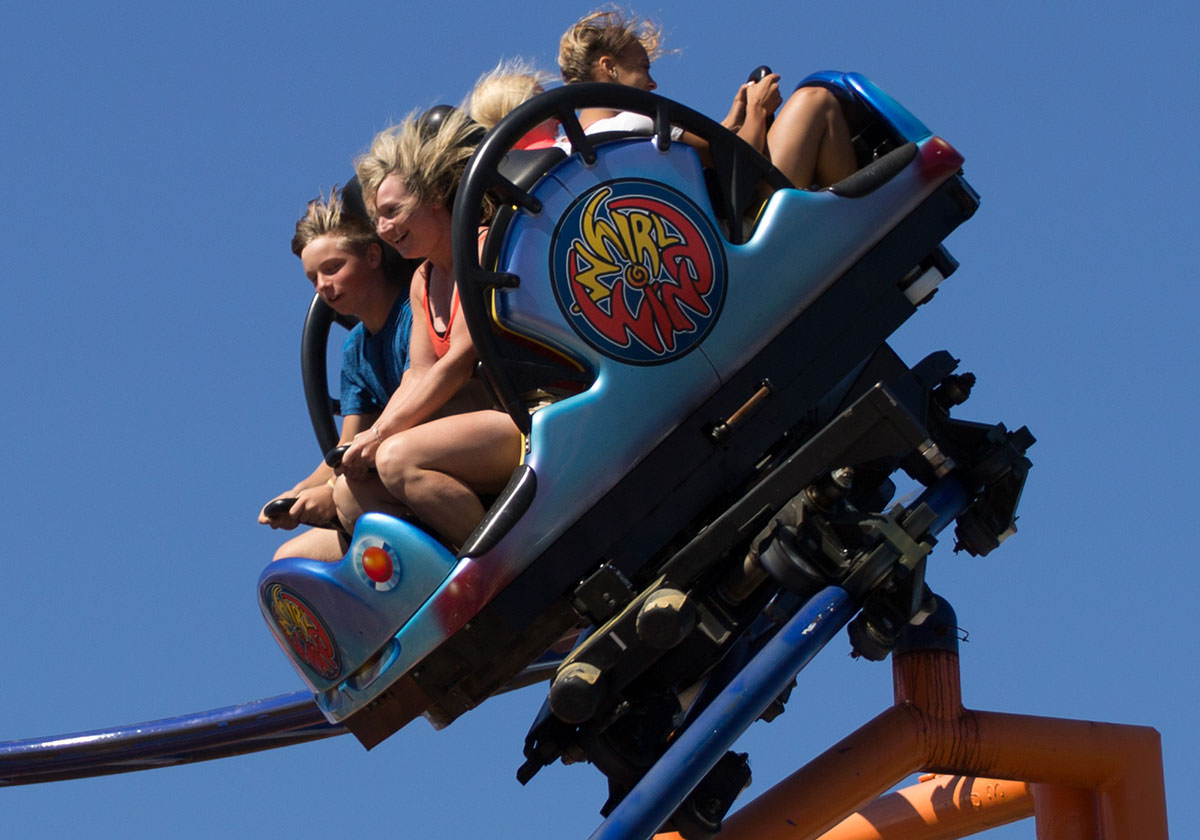 Visitors in the air riding the Whirlwind roller coaster
